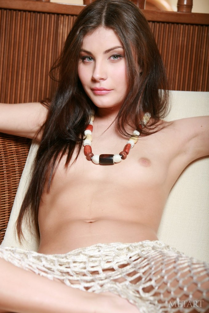 Kinky girl with blue eyes is displaying her flesh