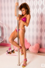 Latina girl dances on a pole in high heels
