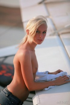 Blonde takes a dip in the sea with no clothes on