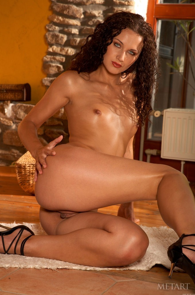 Curly girl with a tight trimmed pussy